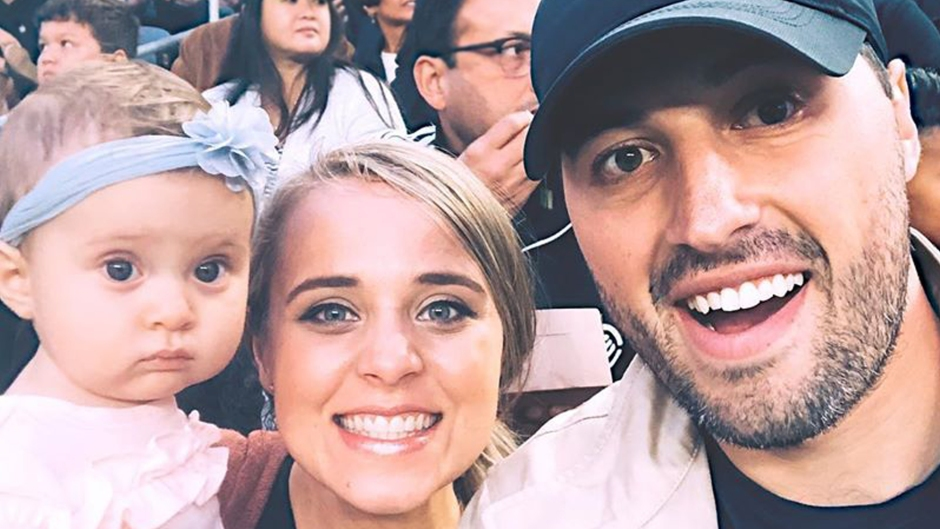 Selfie of Jinger Duggar and Jeremy Vuolo Smiling Holding Their Baby at a Game