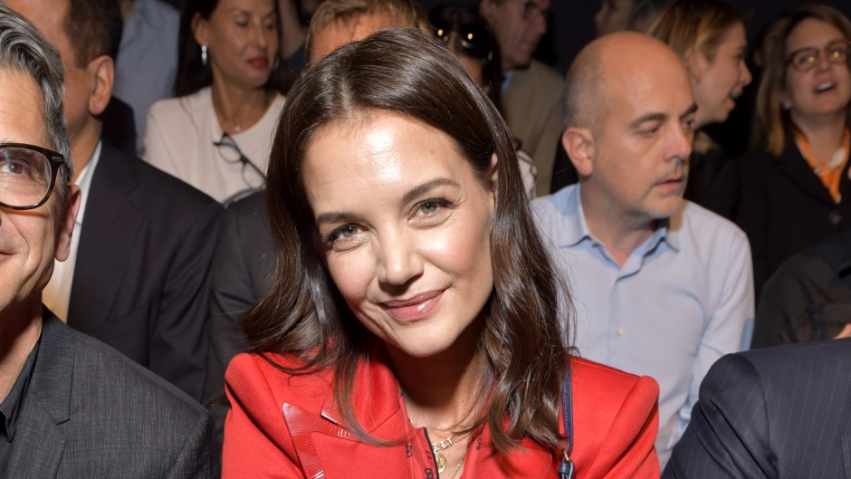 Katie Holmes Wearing a Red Dress During a Fashion Show