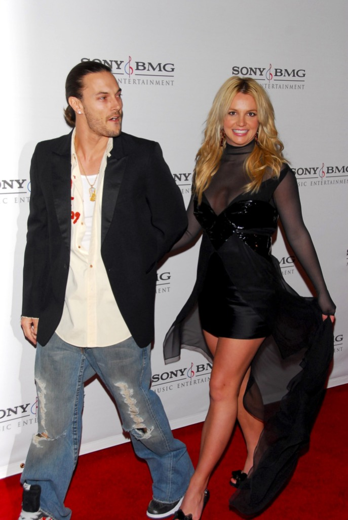 Kevin Federline Wearing Jeans With a White T-Shirt Walking With Britney Spears in a Black Dress at an Event