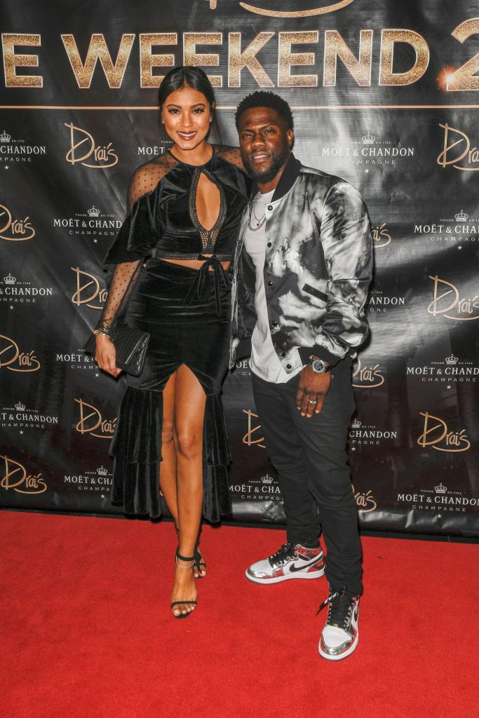 Eniko Hart Wearing a Black Dress With Kevin Hart in a Silver Jacket on the Red Carpet