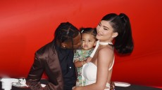 Travis Scott Kissing Stormi With Kylie Jenner Wearing a White Dress