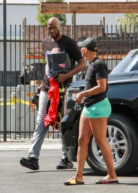 Lamar Odom Wearing a Black T-Shirt With His Girlfriend at the DWTS Studio