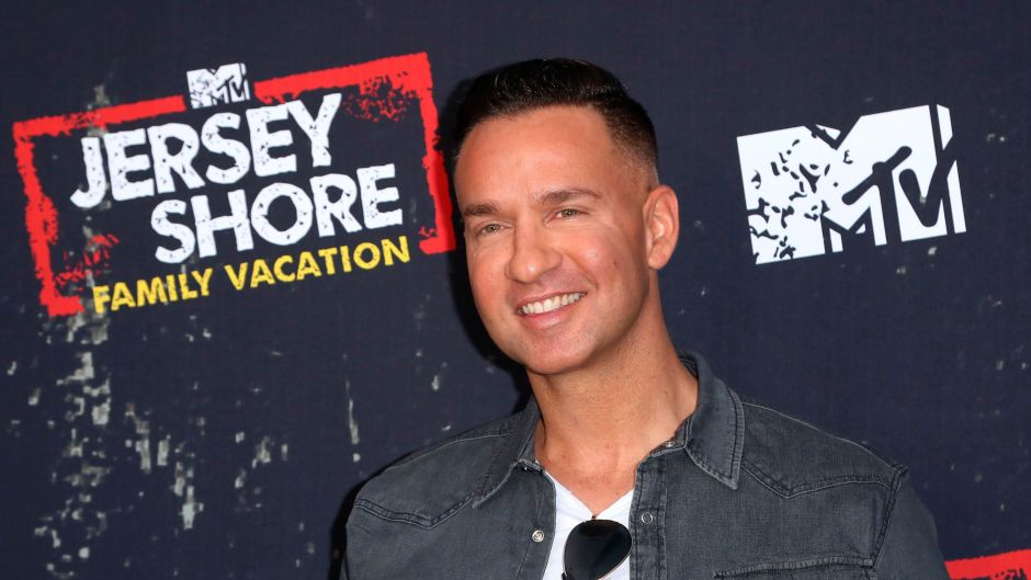 Mike the situation Wearing a Jean Shirt and Smiling