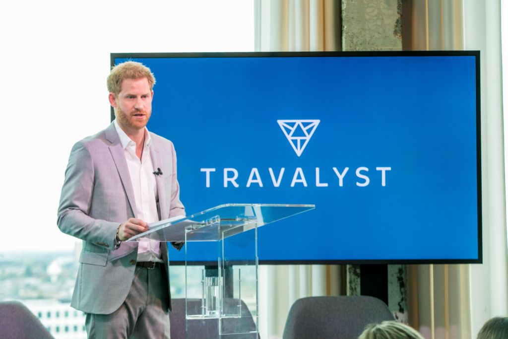 Prince Harry Wearing a Gray Suit Giving a Presentation