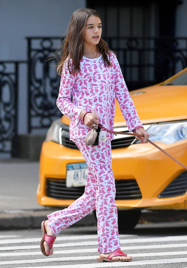 Suri Cruise Is All Grown Up as She Takes Her Dog for a Walk in NYC