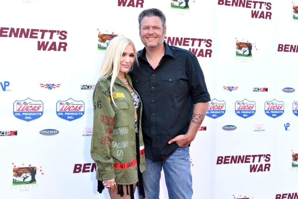 blake shelton and gwen stefani posing at the 'Bennett's War' film premiere