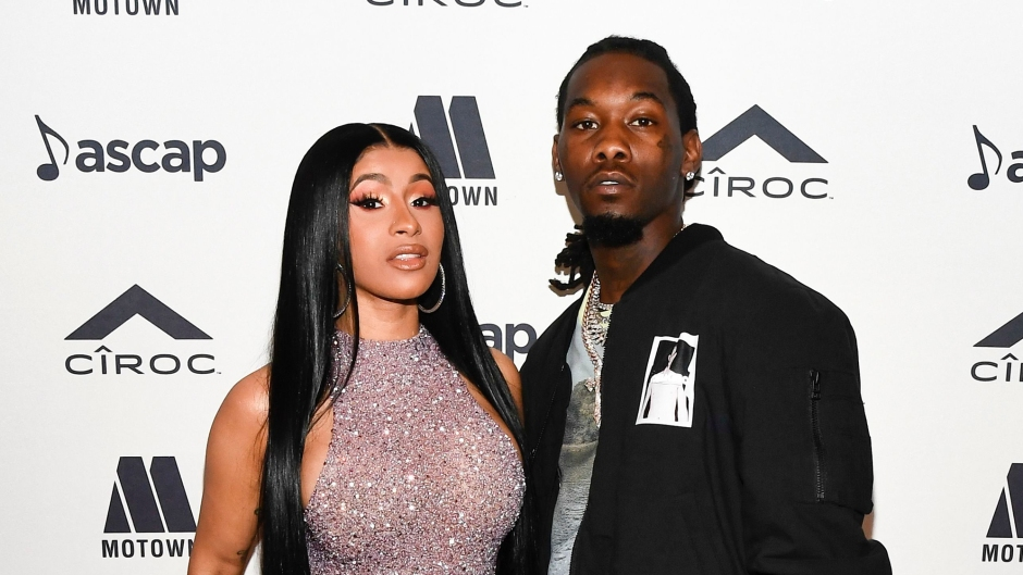 cardi b wears a taupe silver sparkly fitted long gown with a high neck and high thigh slit while offset wears black pants, a blue and white t-shirt and a black jacket at the ASCAP Rhythm & Soul Awards 2019