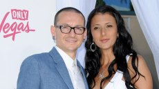 chester bennington wore a white button down t shirt and a light blue blazer and his then-wife talinda work a white dress at a red carpet event in 2012 chester bennington's widow talinda is engaged