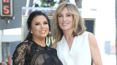 eva longoria wears a black lace dress and felicity huffman wears a white v-neck top on the red carpet at eva's Hollywood Walk of Fame ceremony in Los Angeles in April 2018 eva longoria defends desperate housewives costar felicity huffman