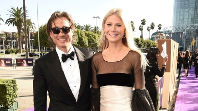 gwyneth paltrow wore a cream and black color blocked gown while her husband brad falcuk wore a classic black and white tuxedo on the 2019 emmys red carpet