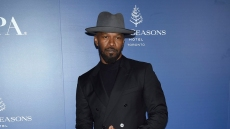 jamie foxx wears an all black suit and a gray hat at the HFPA and THR TIFF Party