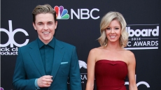 jesse mccartney wore a monochromatic teal blue suit while katie peterson wore a wine red strapless dress at a red carpet event jessie mccartney and katie peterson engaged