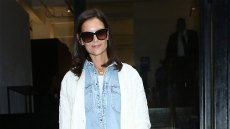 katie holmes wearing a white tee under a blue denim button down shirt under a white sweater with black leather pants and black high heeled boots at the Elie Tahari Spring 2020 Runway Show katie holmes attends elie tahari spring 2020 runway show at nyfw 2019