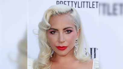 lady gaga wears her blonde hair in vintage old hollywood curls and her makeup look featured a red lip and she accessorized with diamond earrings at the 2019 daily front row fashion awards lady gaga and boyfriend daniel horton go on a date to a cure concert