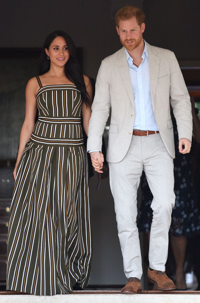 meghan markle and prince harry walking during africa trip.jpg