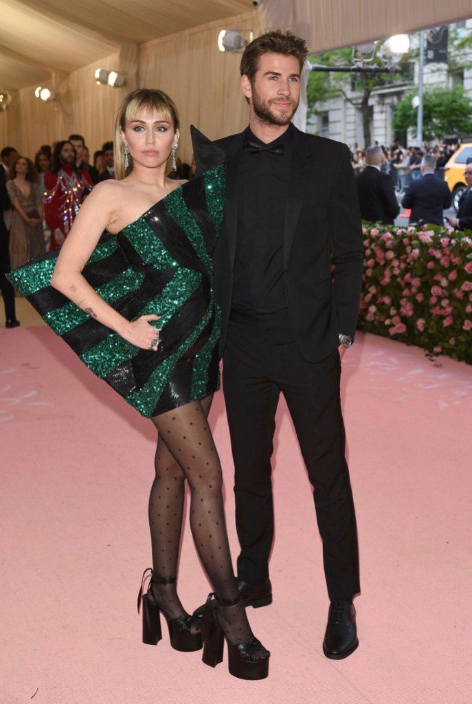 Miley Cyrus, Liam Hemsworth. at the met