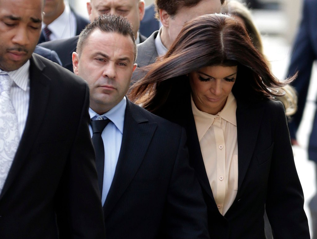 rhonj star teresa giudice and husband joe walking together into courthouse amid legal issues