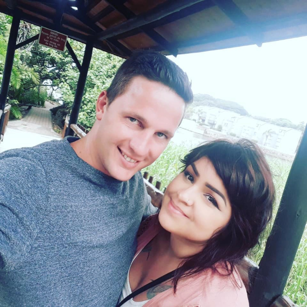 90 day fiance star ronald wears a gray t shirt and tiffany wears a pink top over a white cami in cute couple selfie 90 day fiance are tiffany and ronald still together