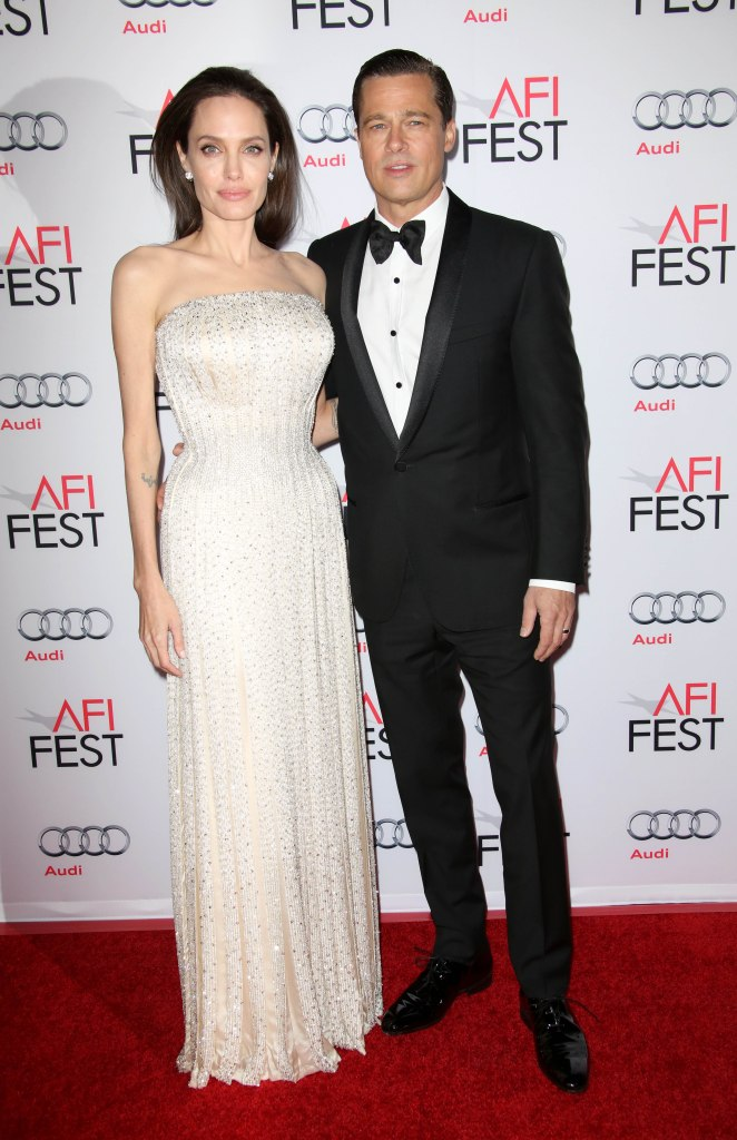 Angelina Jolie Wearing a White Dress With Brad Pitt in a Tuxedo