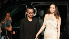 Angelina Jolie Wearing a White Dress holding Hands With Son Maddox in Japan