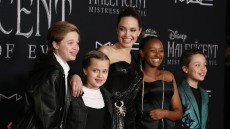 Angelina Jolie Wearing a Black Dress With Her Kids at a Premiere