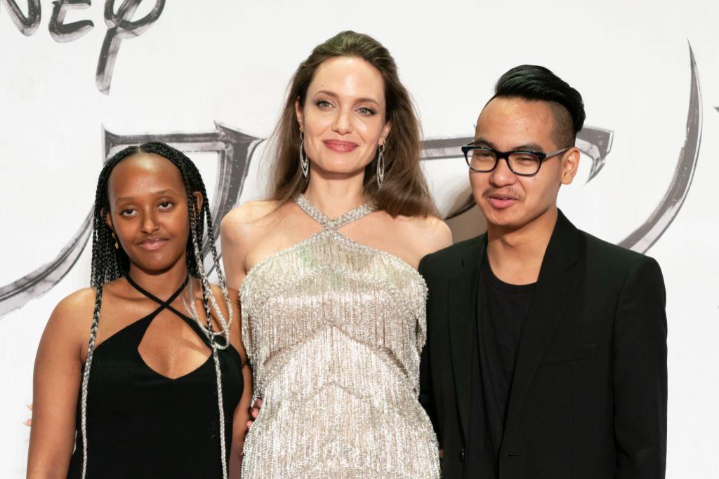 Angelina Jolie Wearing a Silver Dress With Maddox and Zahara
