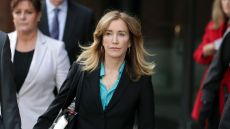 Felicity Huffman Wearing A Black Suit with a Blue Shirt Walking From Court