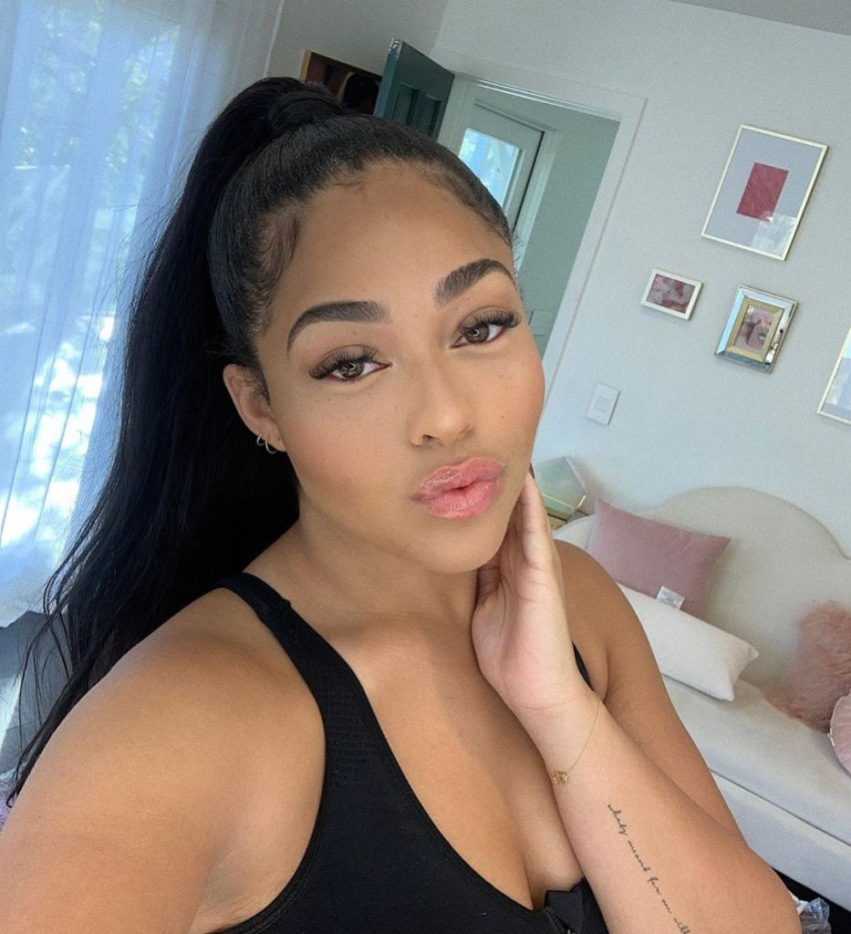 Jordyn Woods Wearing a Ponytail and a Black Shirt