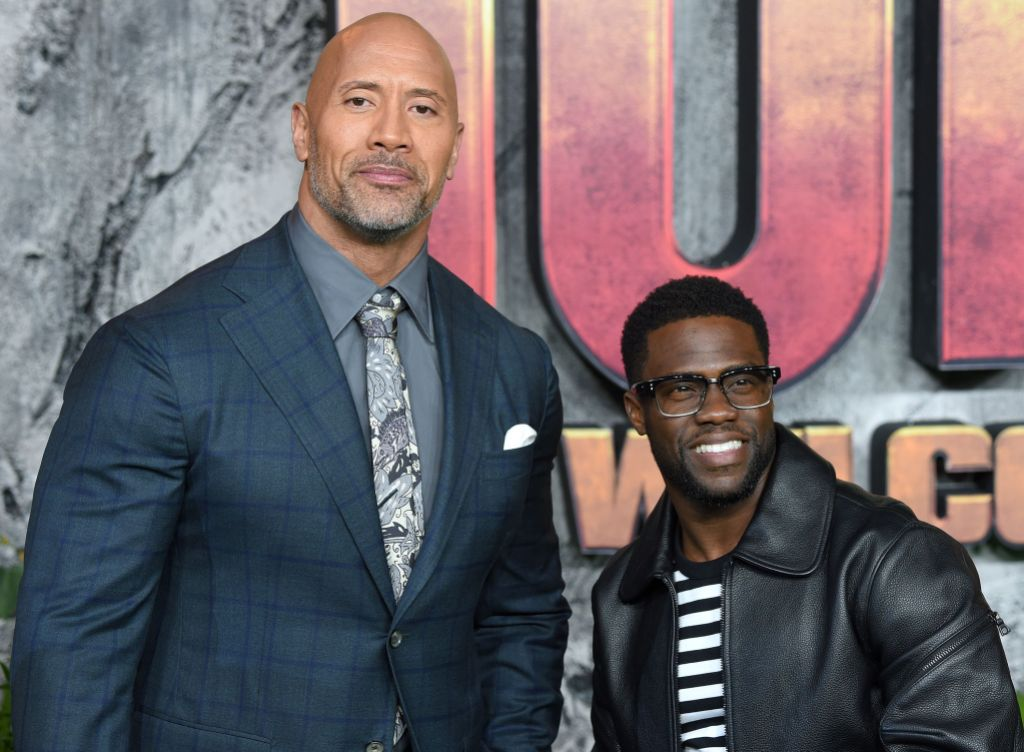 Kevin Hart Wears Glasses With a Leather Jacket While Posing With Dwayne Johnson in a Suit on the Red Carpet