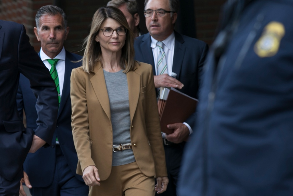 Lori Loughlin Wearing a Brown Suit With Glasses