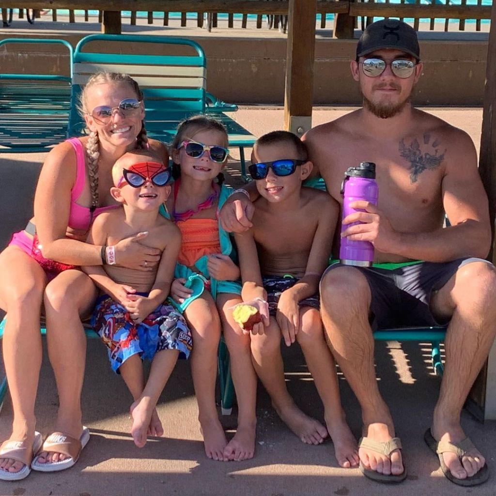 Mackenzie and Josh McKee at Water Park With Three Kids