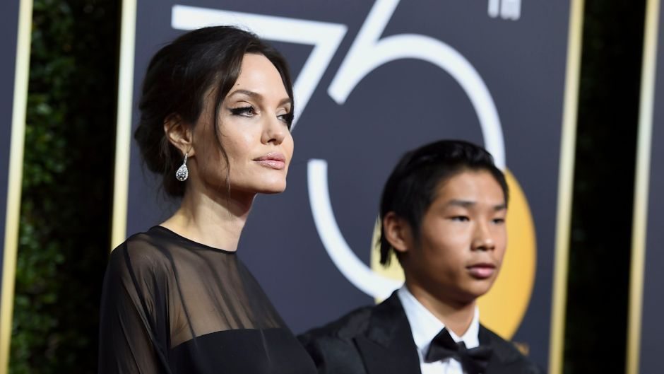 Angelina Jolie Wearing All Black With Maddox in a Suit