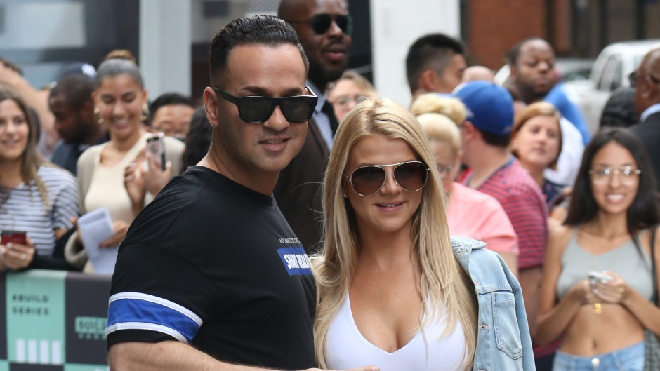 Mike Sorrentino Wearing Jeans and Sunglasses With His Wife Lauren in a White Tank Top on the Sidewalk