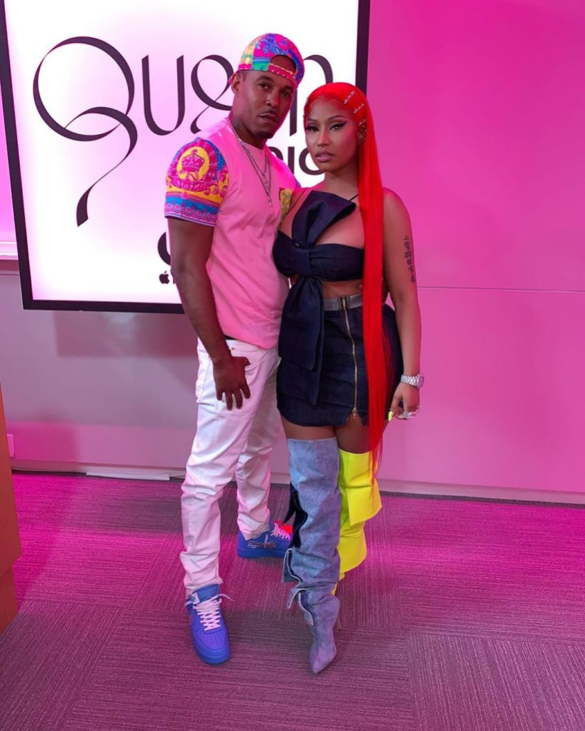 Kenneth Petty Wearing Jeans and a t-Shirt With Nicki Minaj in a Black Dress