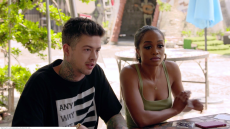 Rachel Lindsay Wearing a Green Tank Top Talking With Travis Mills