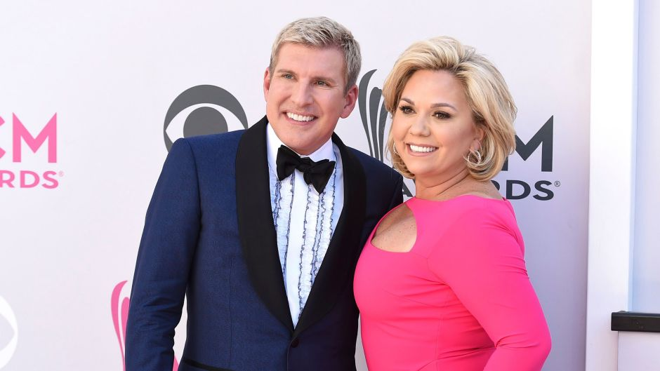 Todd Chrisley Wearing a Suit With His Wife in Pink