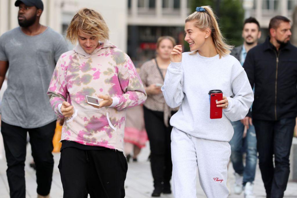 Justin Bieber Wearing a Tye Dye Shirt With Black Pants With Hailey Baldwin in Grey Sweatshirt