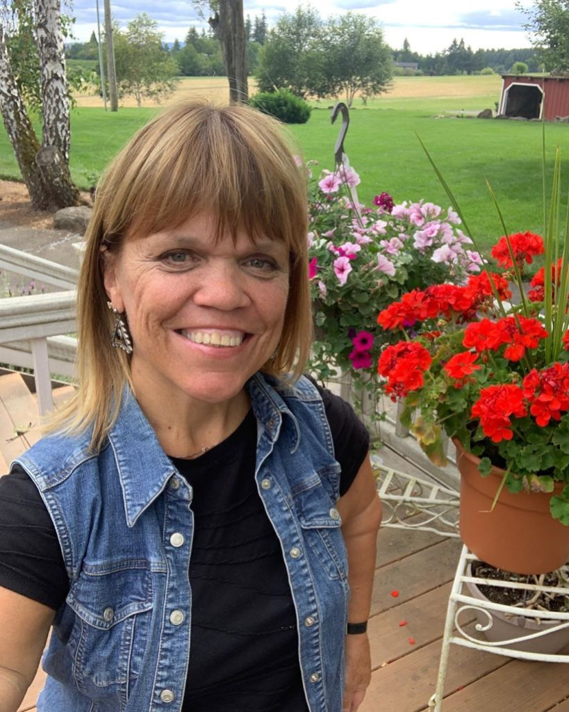 amy roloff selfie in front of plants
