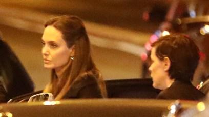 angelina jolie wears a black coat as she arrives for a dinner with her godmother, jacqueline bisset