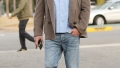 ben affleck wears a blue button down shirt with a brown jacket, jeans, and navy blue shoes ben affleck appears drunk leaving unicef masquerade ball