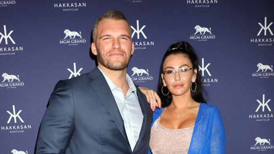 jersey shore star jwoww wears a nude two-piece crop top and skirt with a blue sweater over it; zack clayton carpinello wears a light blue button down shirt underneath a navy blue blazer; jwoww and zack clayton carpinello reunite after split
