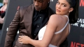 kylie jenner wears white dress travis scott wears black shirt with brown suit at his netflix documentary premiere kylie jenner travis scott take break from their relationship