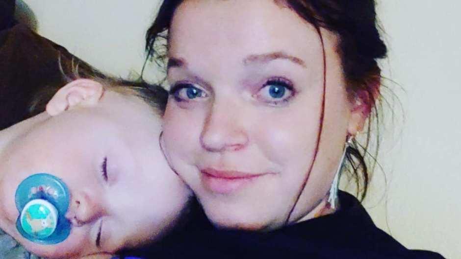maddie brown selfie while axel sleeps on her shoulder
