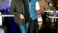 meghan king edmonds wears a denim jacket with patchwork sleeves with black jeans and boots while jim edmonds wears black shirt army green jacket and jeans
