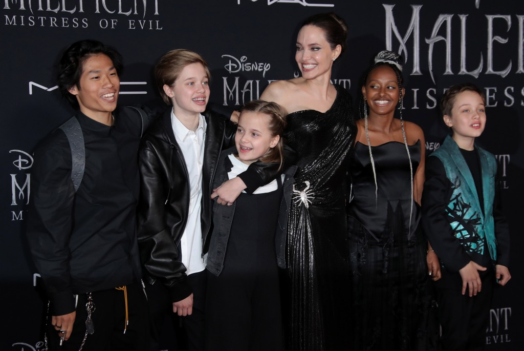 Angelina Jolie Wearing a Black Dress With Her Kids