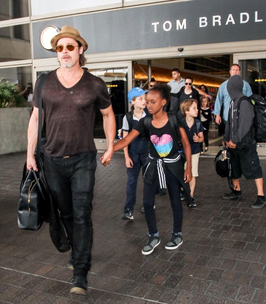 Brad Pitt Wearing Hat and Sunglasses Waklking With Kids