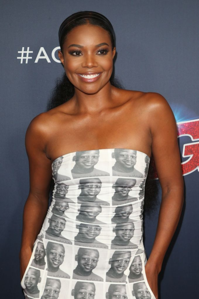 Gabrielle Union on the set of America's Got Talent Wearing a White and Black Dress