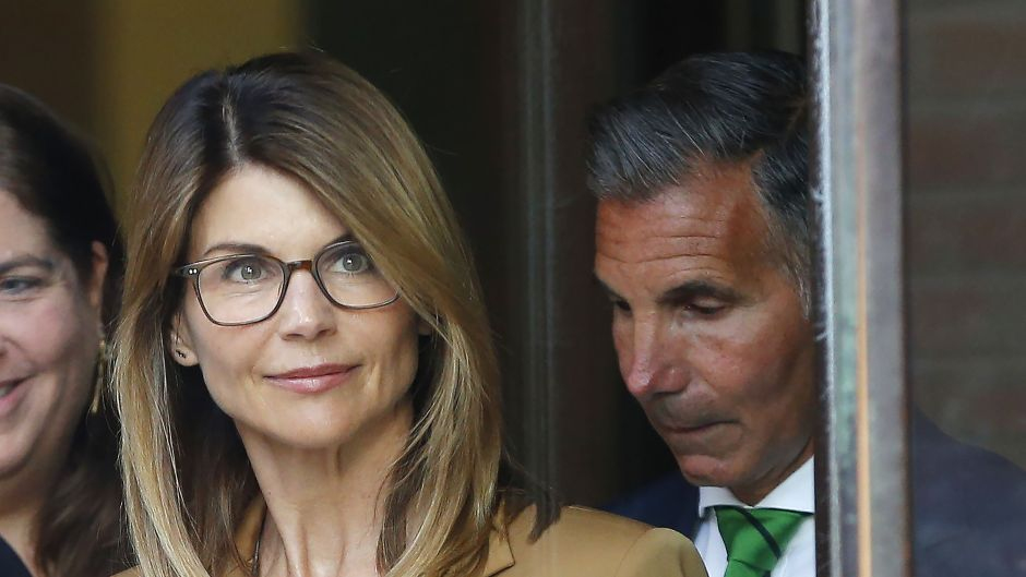 Lori Loughlin Wearing a Brown Suit With Her Glasses On