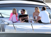 Scott Disick Wearing a Black Shirt While Wrapping His Arm Around Sofia Richie