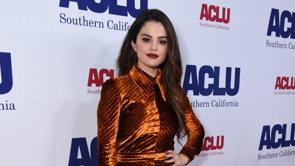 Selena Gomez Wearing an Orange Velvet Jumpsuit With Black Heels